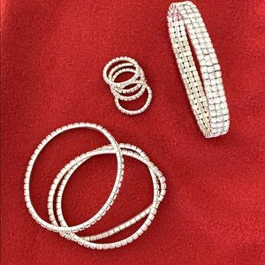 Rhinestone bracelets and rings. 8 pieces total.